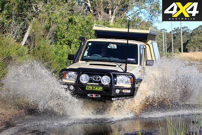 Custom Toyota LandCruiser 79 GXL driving through water