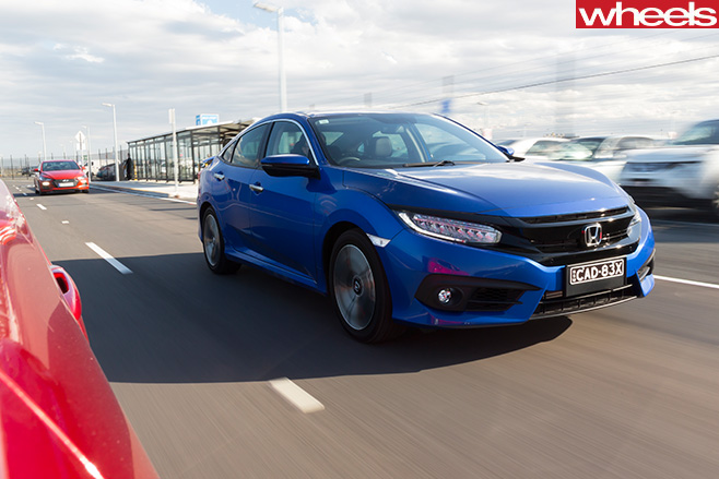 2016-Honda -Civic -RS-driving -front -side