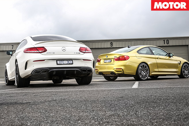 Mercedes -AMG-C63-S-Coupe -vs -BMW-M4-Competition -rear