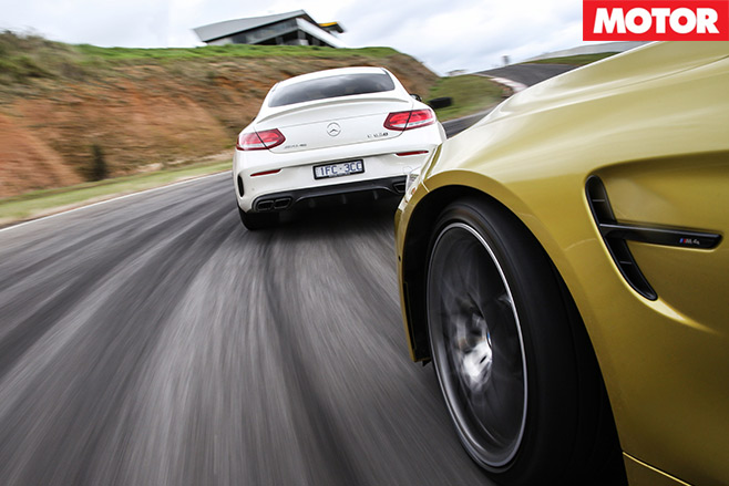 Mercedes -AMG-C63-S-Coupe -vs -BMW-M4-Competition -racing