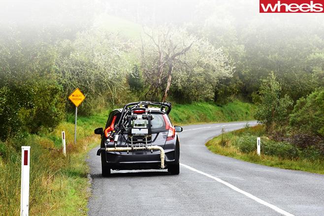 AAA-emissions -testing -car -rear