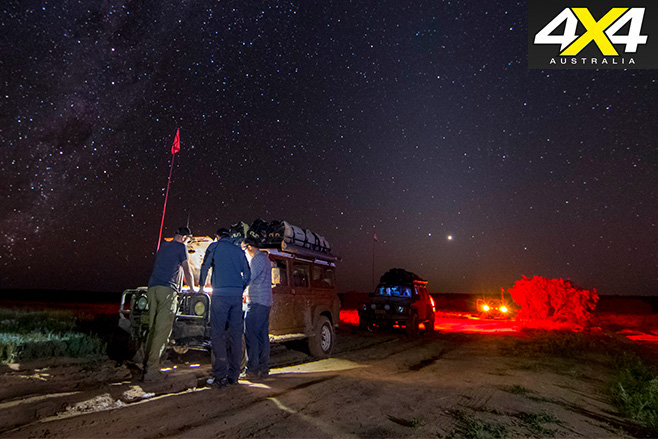 Fixing the cars under the stars