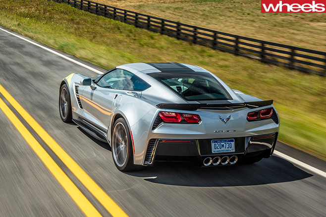 2017-Chevrolet -Corvette -C8-driving -rear -side