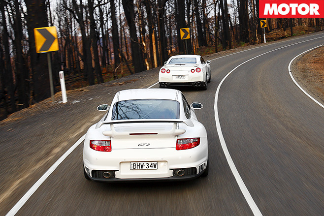 Nissan -GT-R-vs -Porsche -911-GT2-rear -driving