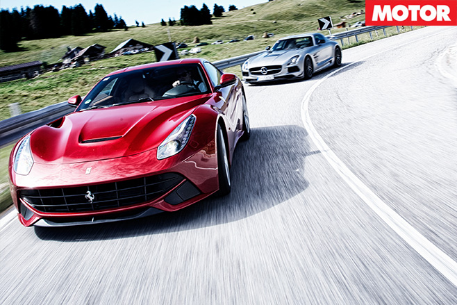 Ferrari -F12-Berlinetta -vs -Mercedes -Benz -SLS-AMG-Black -Series -turning
