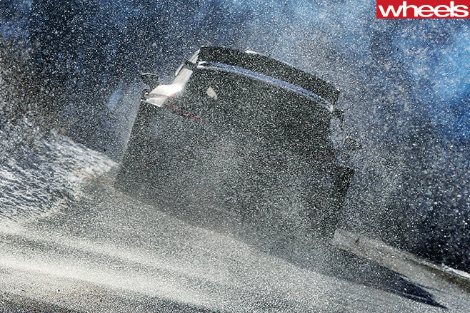 Hyundai -i 20-rally -car -kicking -up -snow