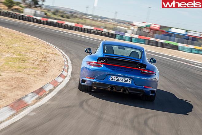 2017-Porsche -911-GTS-driving -rear