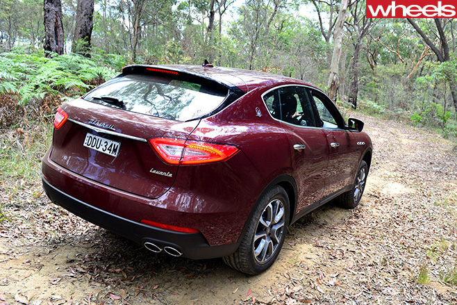 2017-Maserati -Levante -driving -rear