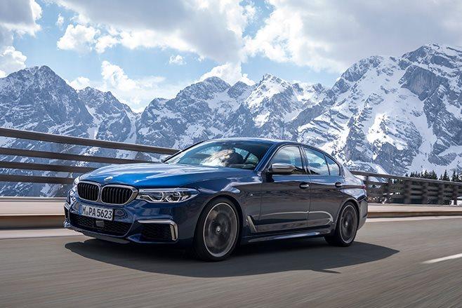 2018 BMW M550d xDrive driving alps
