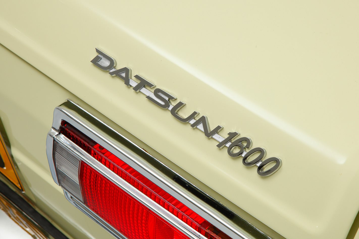 Datsun 1600 badge