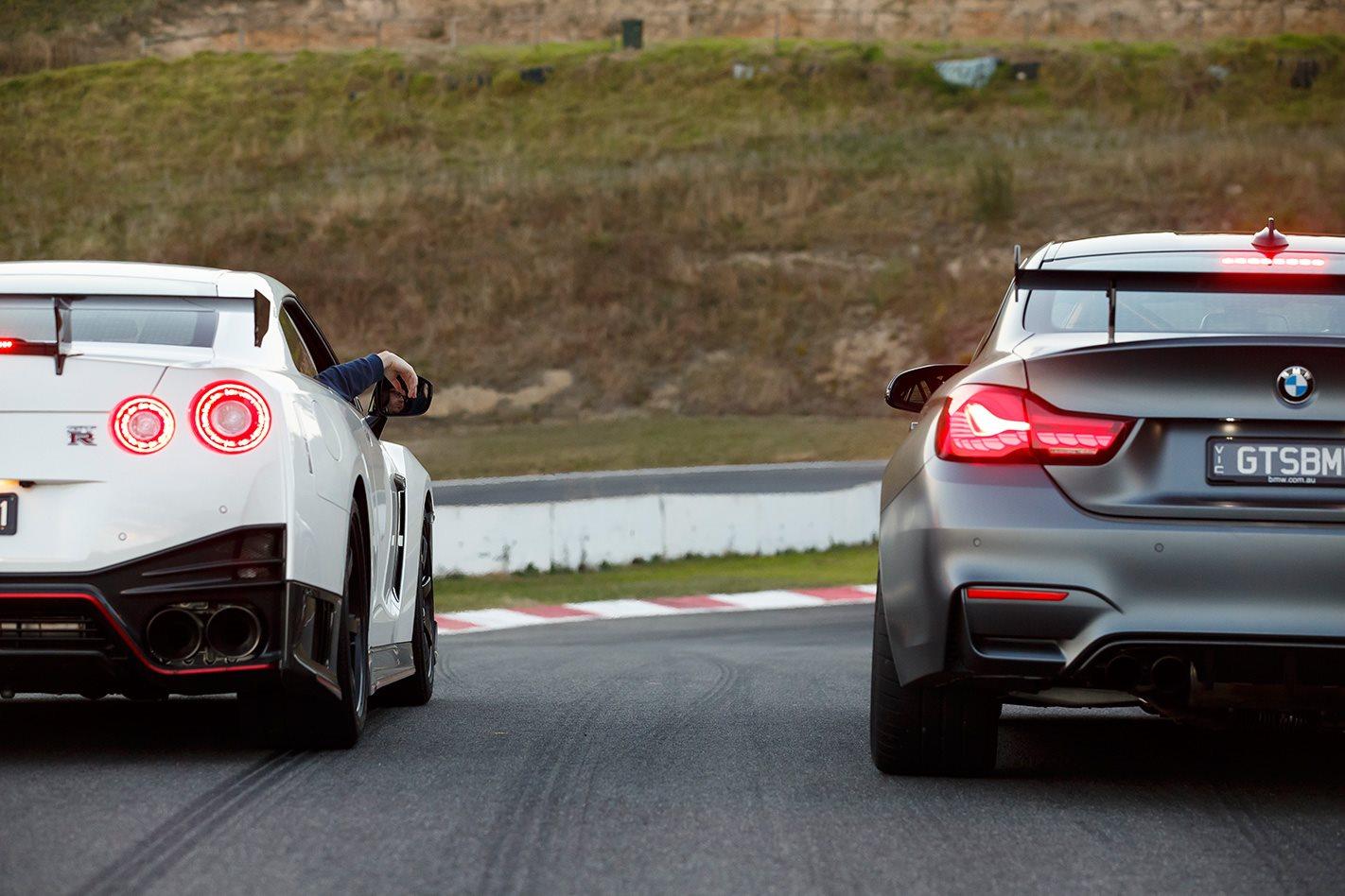 2017 Nissan GT-R NISMO vs 2017 BMW M4 GTS tailights.jpg