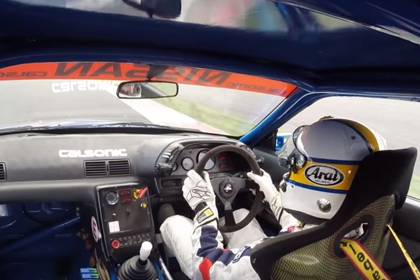 Kazuyoshi Hoshino driving Calsonic Nissan R32 GT-R