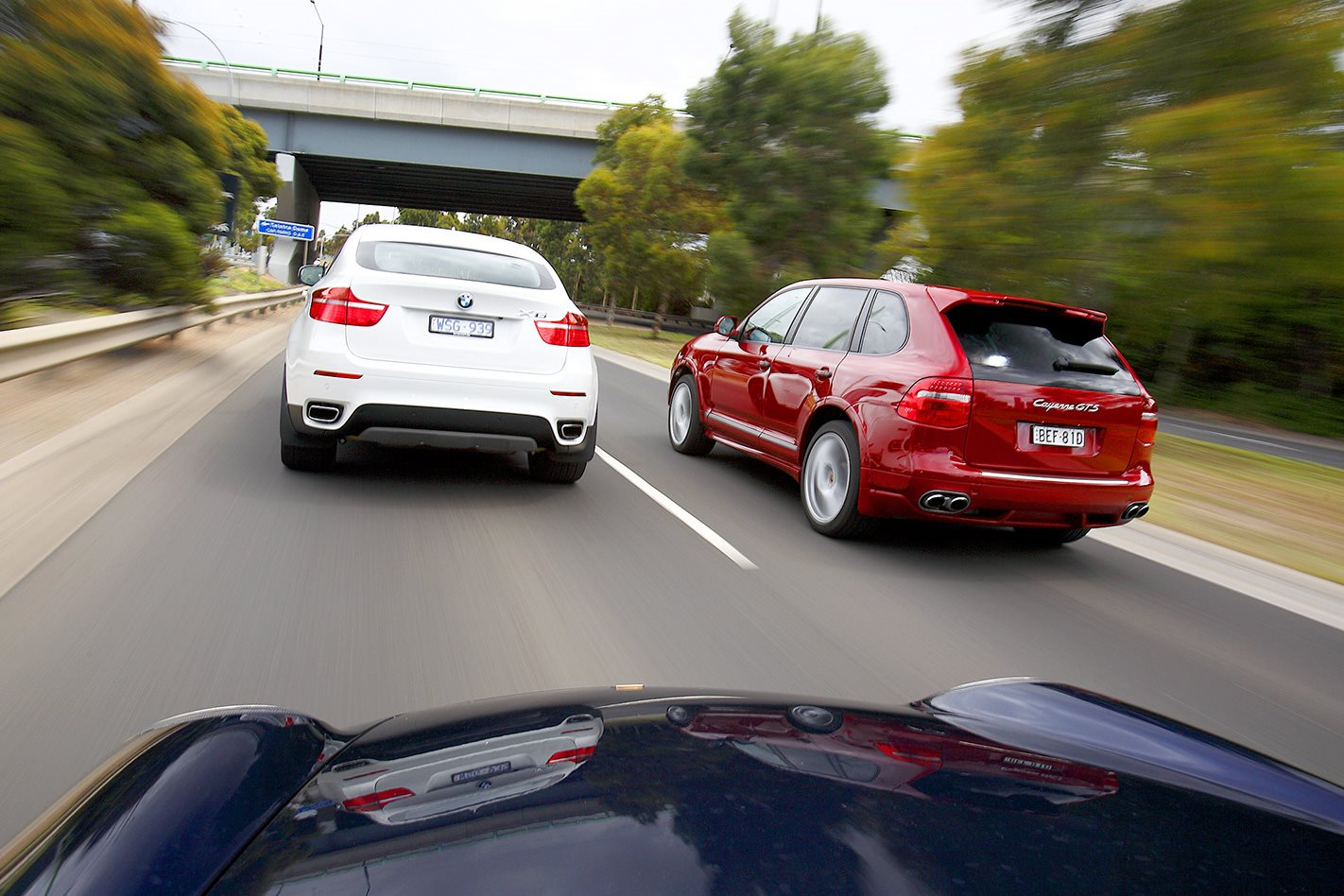 Porsche Cayenne GTS vs BMW X6 rear