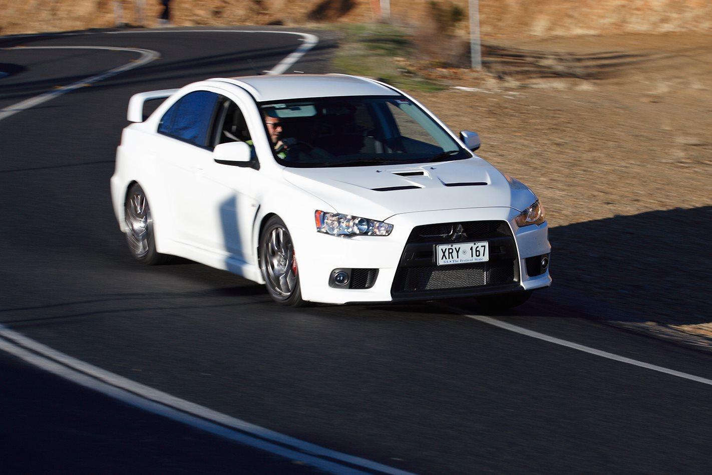 2008-Mitsubishi-Lancer-Evo-X-on-the-road.jpg