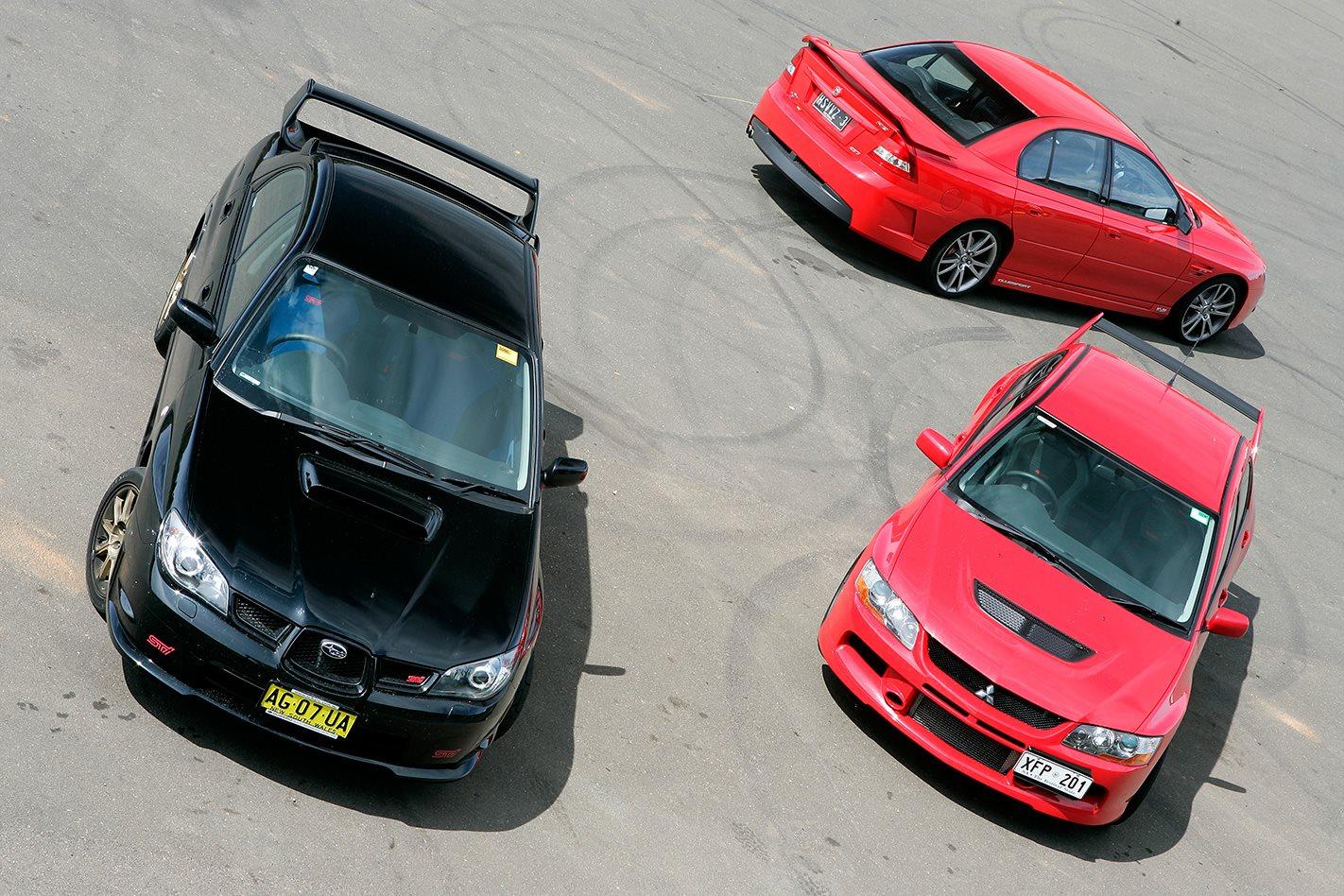2005 Subaru WRX STi vs Mitsubishi Evo IX vs HSV Clubsport.jpg