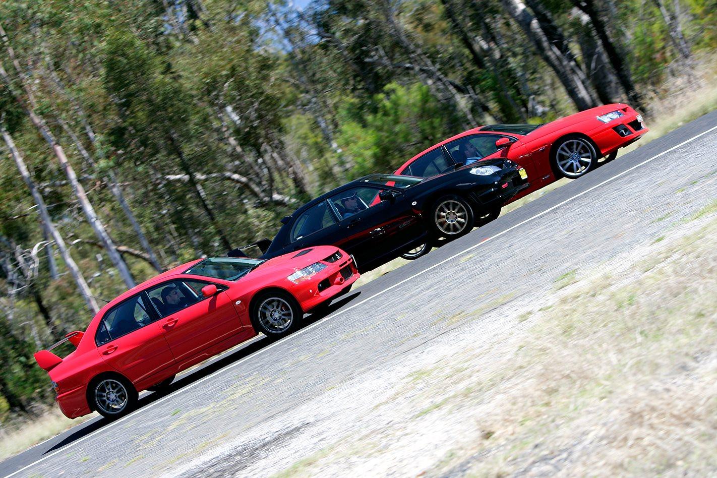 Subaru WRX STi vs Mitsubishi Evo IX vs HSV Clubsport exterior.jpg
