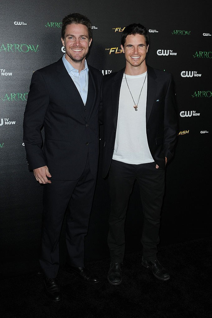 Arrow's Stephen Amell and Robbie Amell are cousins. One thing is for sure, good looks run in the family.