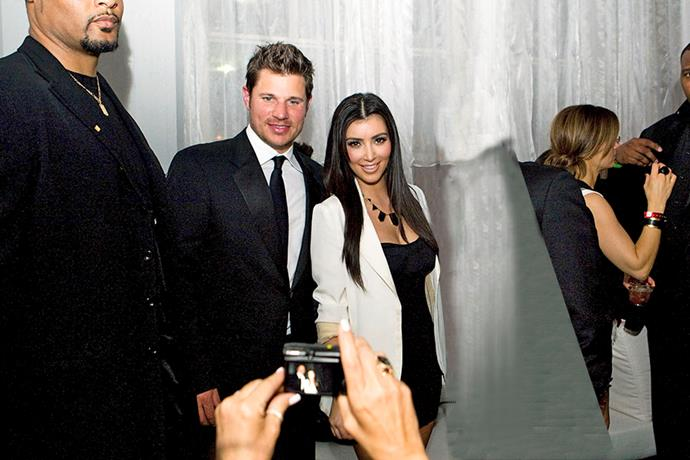 **Kim Kardashian & Nick Lachey**  Long before Kim got her hands on a smartphone, she relied on the old point-and-shoot camera for a snap with her flavour of the month, Nick Lachey.