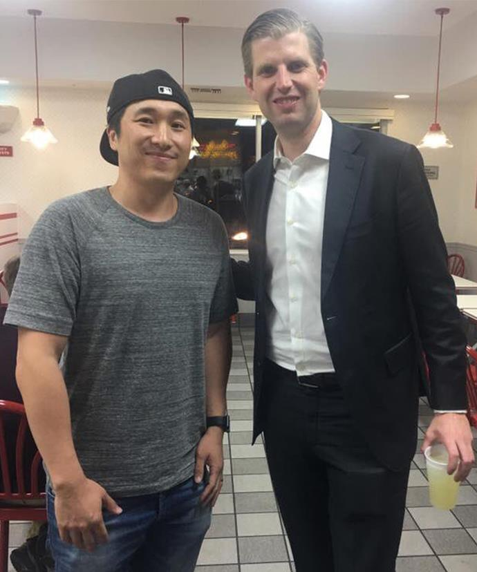 Eric coyly holds his free cup of lemonade as he poses with a fan.