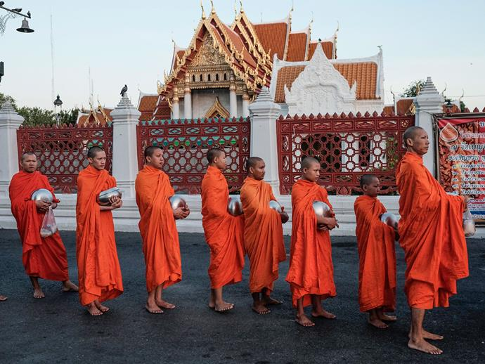 Buddhist monks gather outside the Marble Temple.