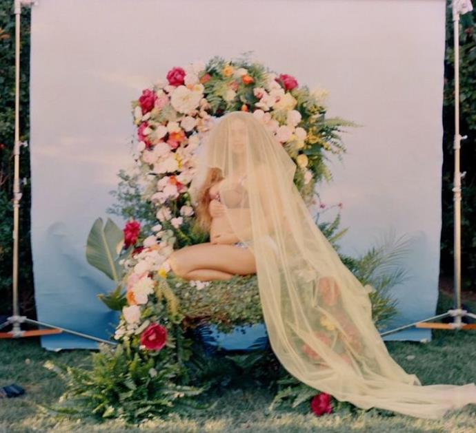 This zoomed out shot shows the dramatic veil from her announcement photo in full. Impressive, no?