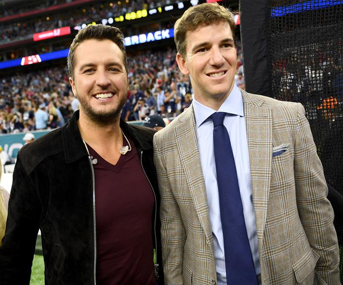 Country singer Luke Bryan (L) with Eli Manning.
