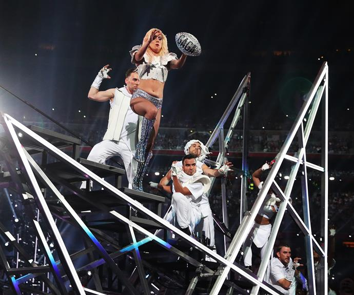 This ending is everything! To cap off her incredible show, Gaga was thrown a football with her name emblazoned across it. As she caught it, she jumped and vanished from the stage. **Watch the spine-tingling ending in the next slide!**