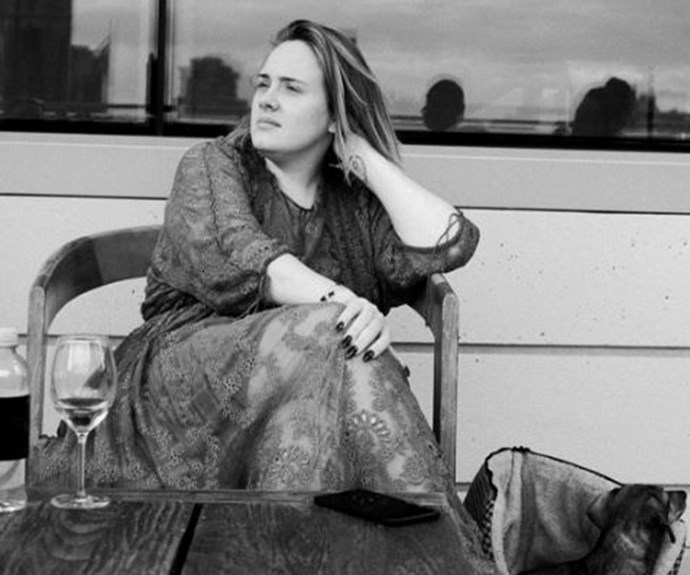 Adele takes a break with a glass of vino in this moody Insta.