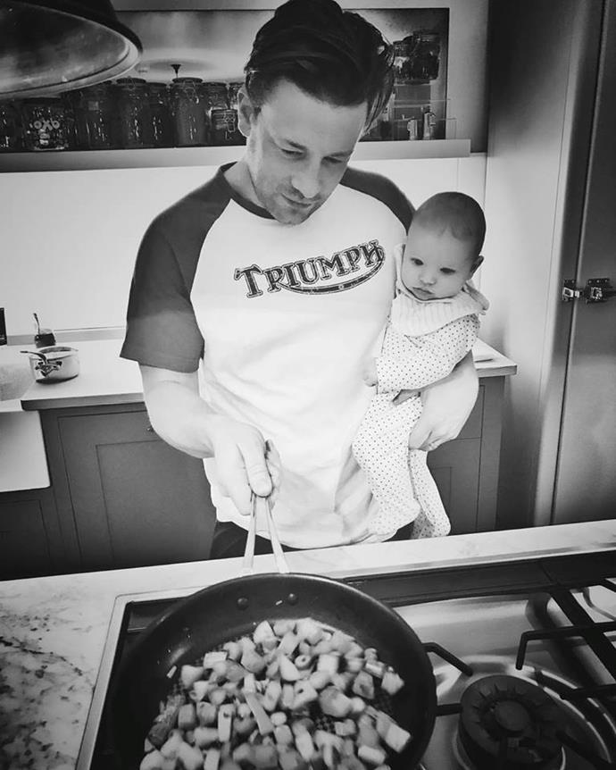 "Jamie Oliver is teaching baby River the ropes in this adorable snap posted on his Facebook. Captioning the sweet image ""Gotta start them young!..... bless baby River he's so fascinated by the cooking,"" we wonder if River has a future job lined up for him in dad's kitchen."