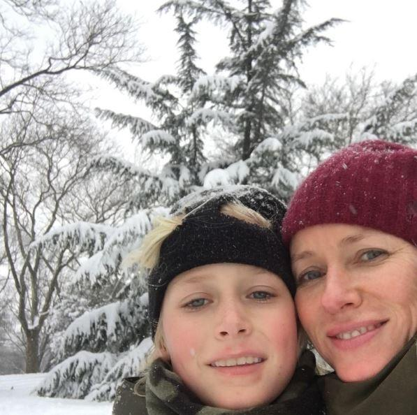 It's a snow day in NYC, and Naomi Watts is taking advantage on the Winter wonderland with her look-alike son.