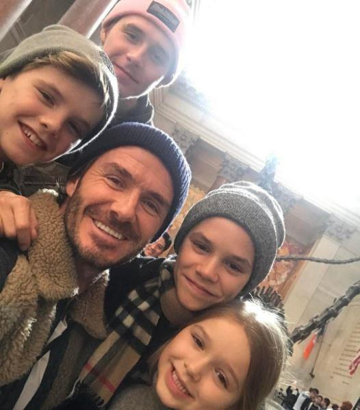 "David Beckham posted this cute photo on his Instagram with his four kids, captioning it: ""Nice day in NYC & a great few hours at the Natural History Museum ❤❤❤❤ Keeping the littlest ones busy whilst mum works on the collection......"""