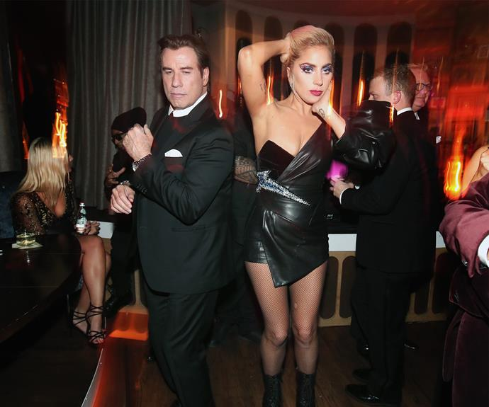 John Travolta and Lady Gaga do their best *Saturday Night Fever* impression at the Interscope after party.