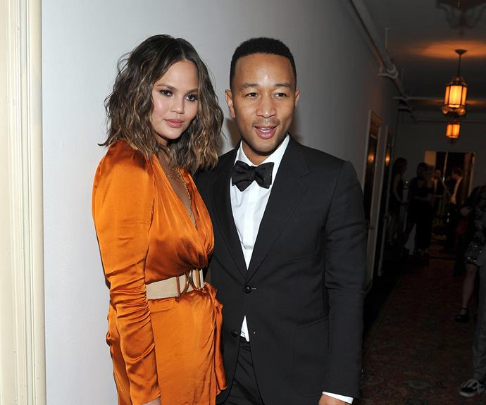 Chrissy Teigen and John Legend cuddle up at the GQ and Chance The Rapper bash at LA's Chateau Marmont. **WATCH: Chrissy's hilarious drunk snapchats!**