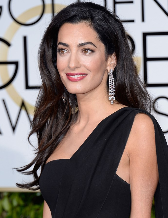 "**FLAWLESS SKIN:** For the 2015 Golden Globes, go-to makeup artist Charlotte Tilbury got Amal's skin looking like perfection by applying [Magic Cream](http://www.charlottetilbury.com/au/charlottes-magic-cream.html) to Amal's entire face, followed by [Wonderglow](http://www.charlottetilbury.com/au/wonderglow.html|target=""_blank""