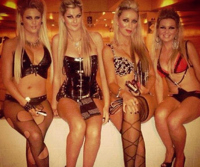 The 25-year-old (second from left) parties with a group of blondes.