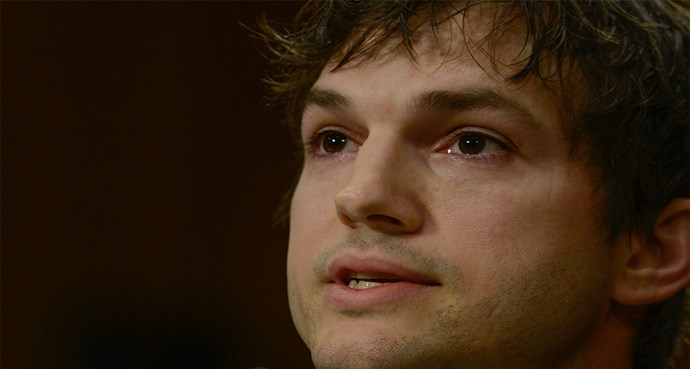 Ashton Kutcher tears up as he describes what he's seen