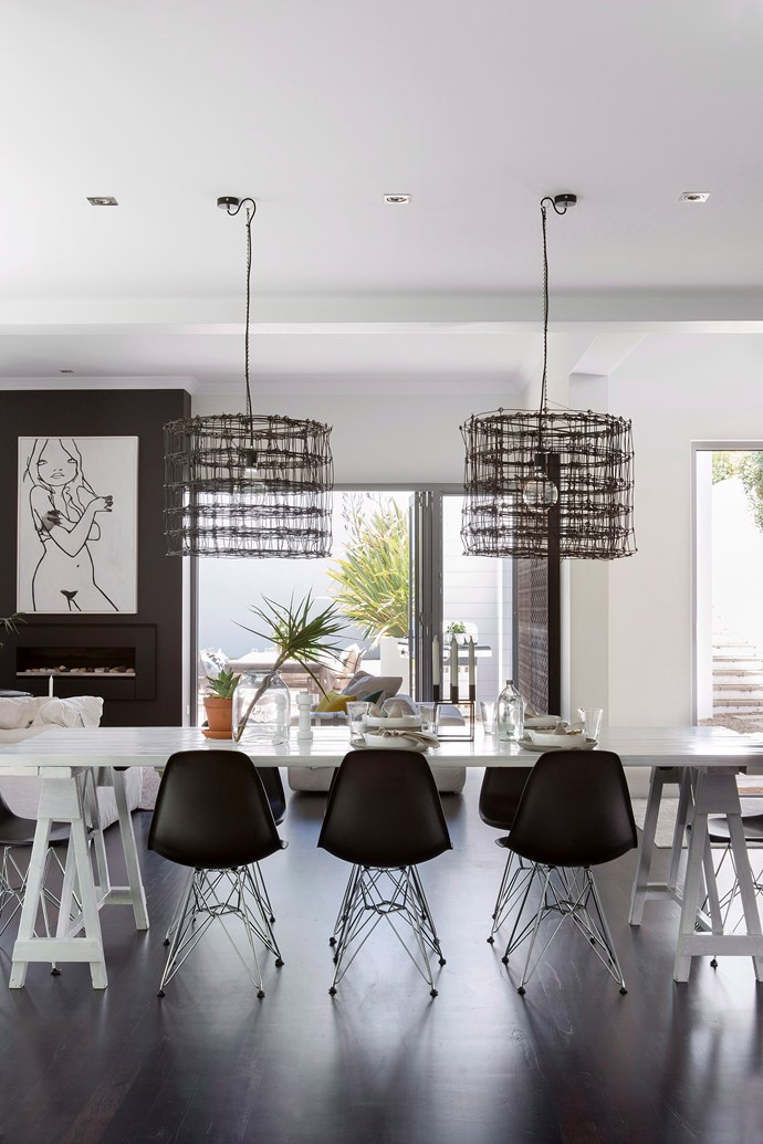 Dreamy dark floors, black chairs and statement pendants all come together in this dining room to create a dramatic and stylish space. If you're on a budget, take one element of this room and introduce it to your home. You can slowly add in others when the time's right. *Photo: Angelita Bonetti / bauersyndication.com.au*