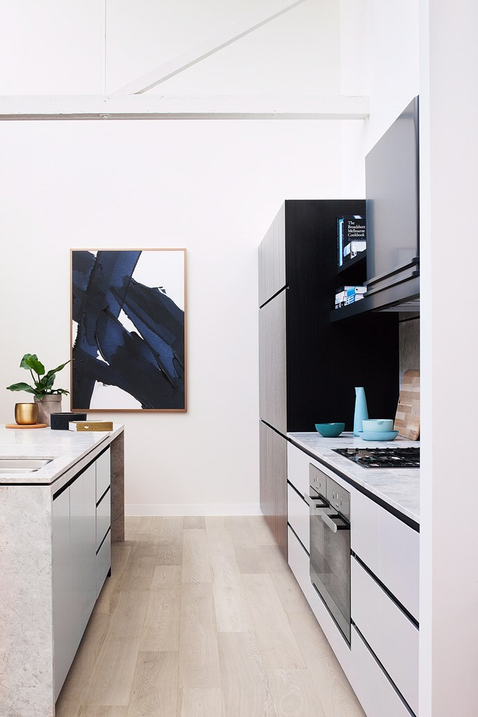 This sleek and contemporary kitchen is a stunning modern update. Use textural finishes such as the industrial-style benchtop and gold accents for a warm and welcoming kitchen that will become the hub of your home. *Photo: John Paul Urizar / bauersyndication.com.au*