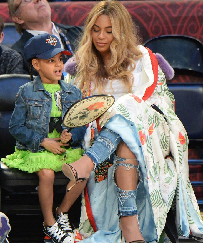 Blue rocked a lime-green dress, a denim jacket and Cons.