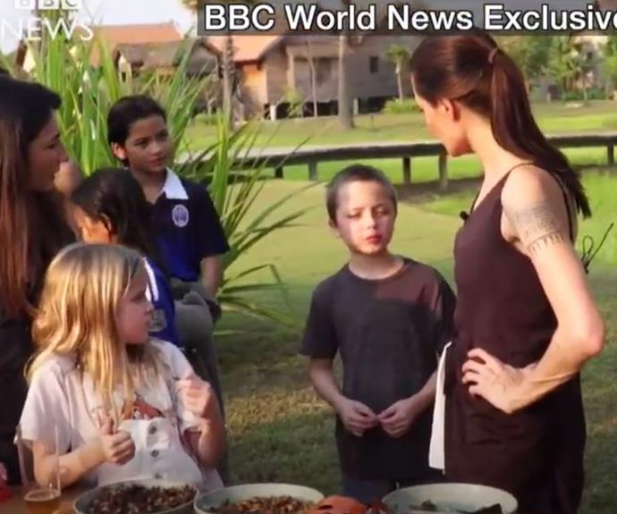 The director has been doing publicity in Cambodia with her children as she gears up for her latest film *First They Killed My Father*. (Image/BBC World News)