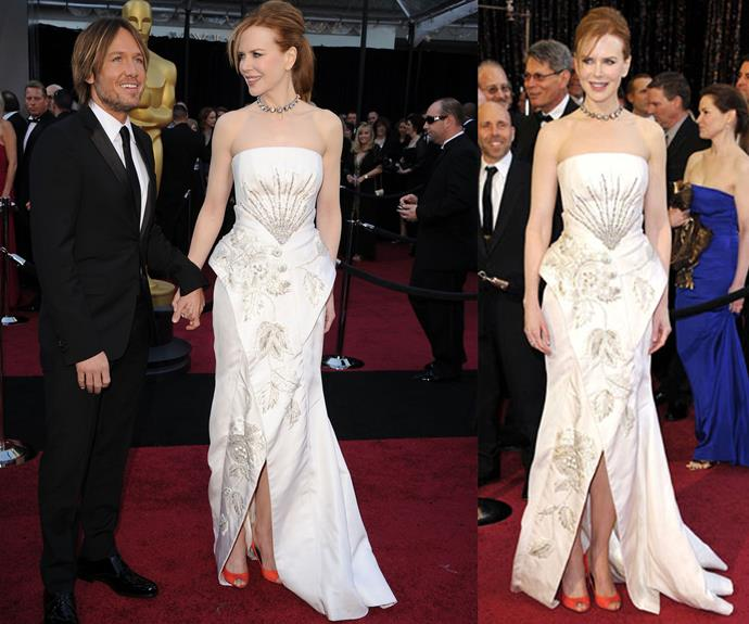 Nicole chose this detailed Christian Dior dress in 2011, and added a flash of colour with neon shoes. She was nominated for best actress for *Rabbit Hole* but sadly didn't take home the golden statue.