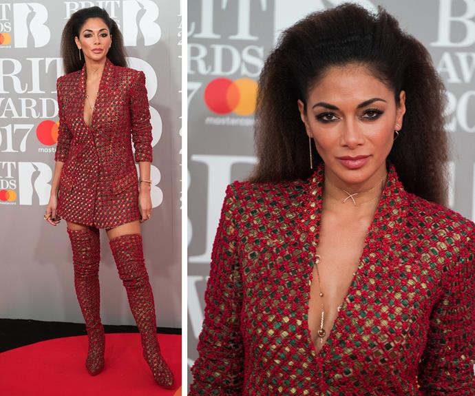 Nicole Scherzinger mixes things up with a vintage inspired suit... And let's take a moment for those knee-high boots.
