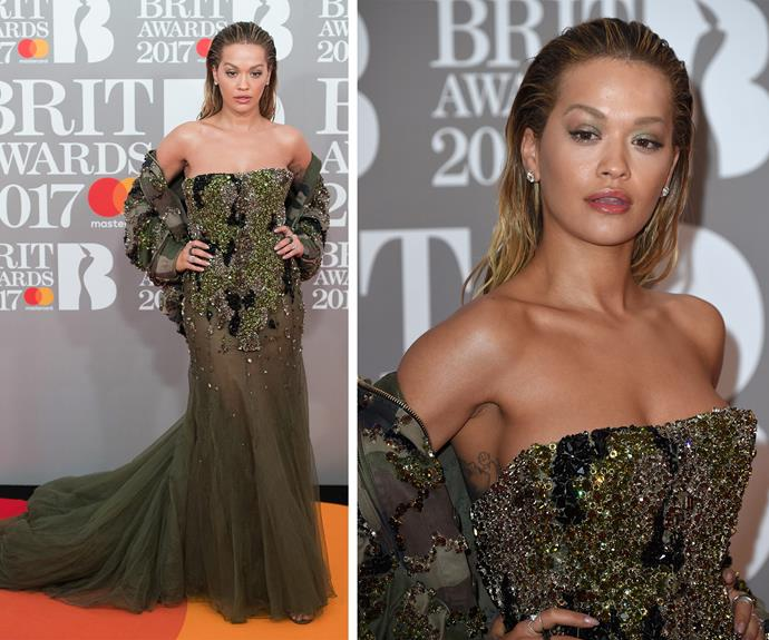 Rita Ora clearly raided her *50 Shades* wardrobe. Opting to shade over her brows, and to give her locks a wet look, the singer channeled her best Beyonce as she pouted on the brightly-hued carpet.