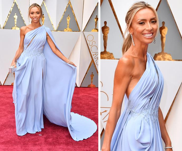 And we're off! Resident red carpet guru Giuliana Rancic is an ethereal goddess as she floats into the 89th Academy Awards in a off-the-shoulder lilac gown by George Schakra.