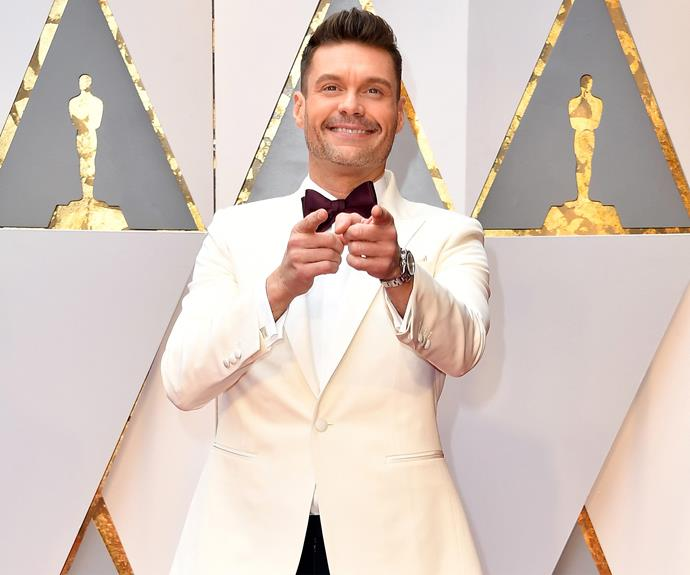 Looking very handsome... Ryan Seacrest points towards a winning day.