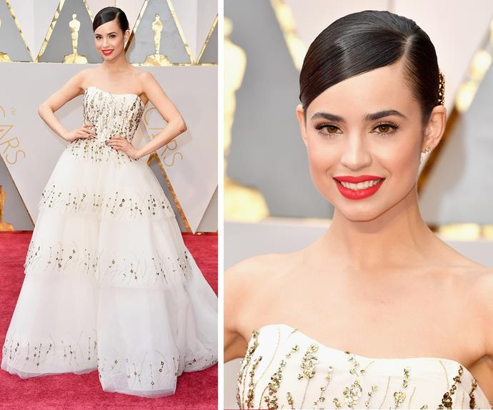 Singer Sofia Carson works a voluminous strapless gown and slicked hair.