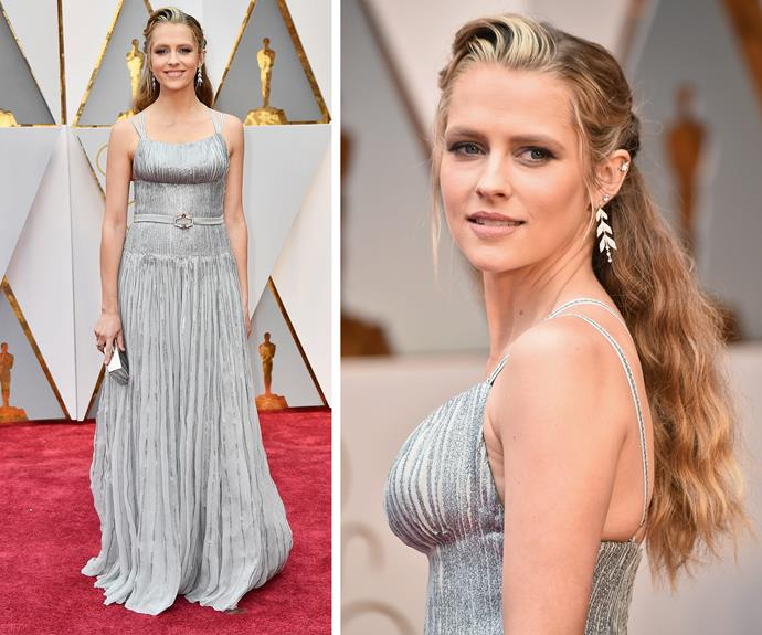 *Hacksaw Ridge* stunner Teresa Palmer, who recently welcomed her second son, oozes elegance in this flowing silver frock. In a special touch, the Aussie stunner is also celebrating her 31st birthday on Oscar's day.