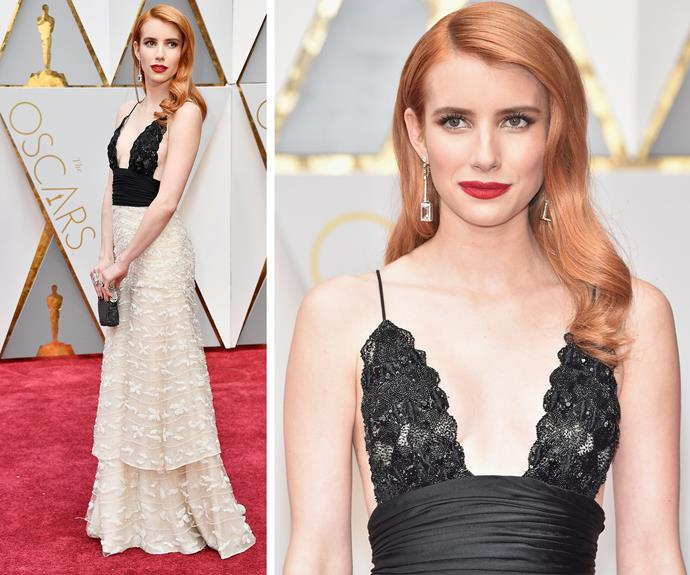 Emma Roberts rocks a plunging Armani Prive dress and a bright copper hair colour.