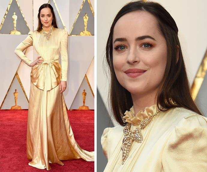 *50 Shades* beauty Dakota Johnson is a vision in this gold Gucci number.