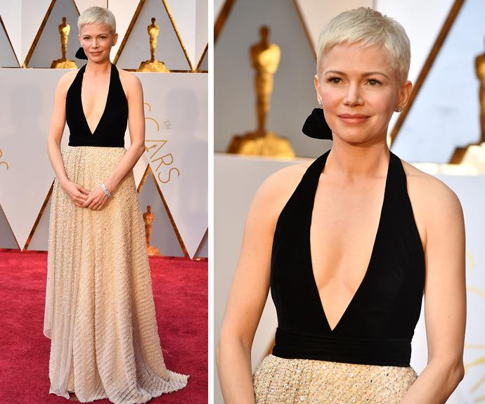 She already looks like a winner! Michelle Williams, who is up for Best Supporting Actress, dazzles in this low-cut black bodice and flowing gold dress.